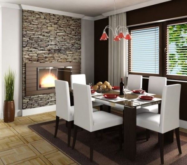 un comedor ventilado y con luz con el detalle de chimenea y pared de piedra - Comedores Decoracion